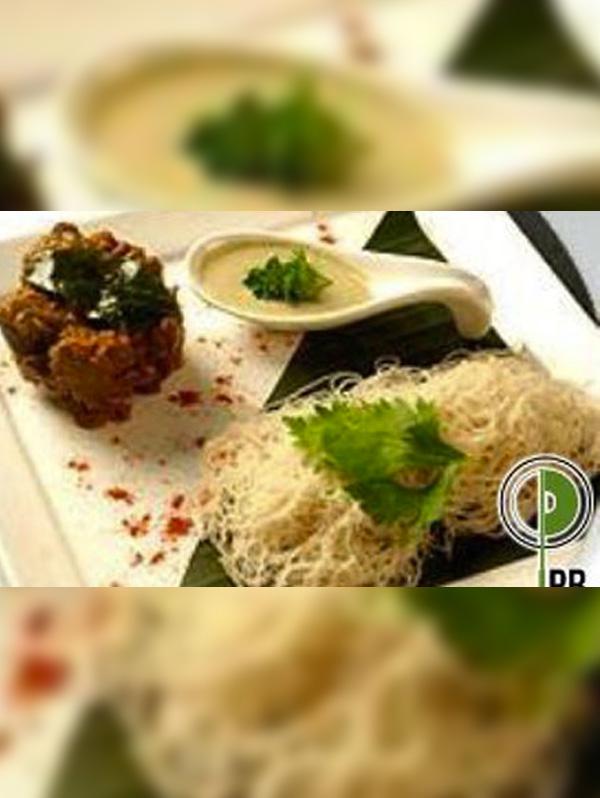 Chettinad Flavored Mutton with Caramalised Onion Walnut Chutney and Iddipams Image