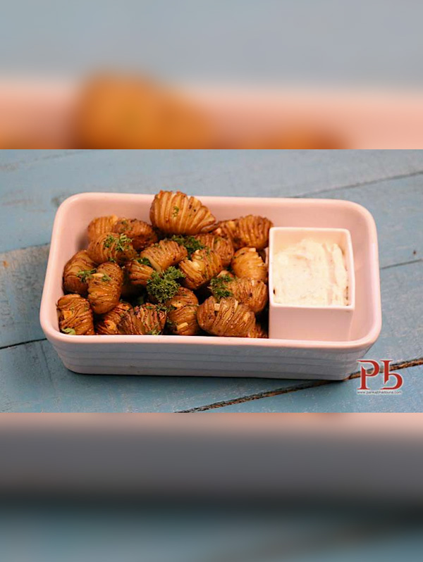 Hasselback Baby Potatoes with Herbed Sour Cream Image